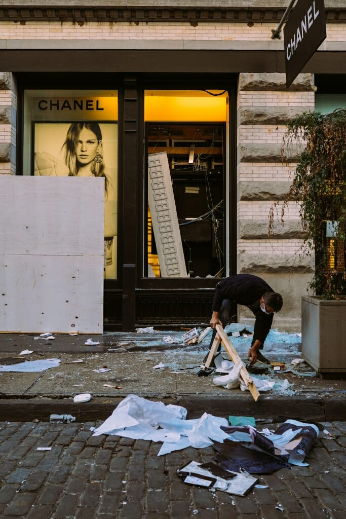 Retailers in Soho clean up the streets after looting after the Black Lives Matter Protests.
