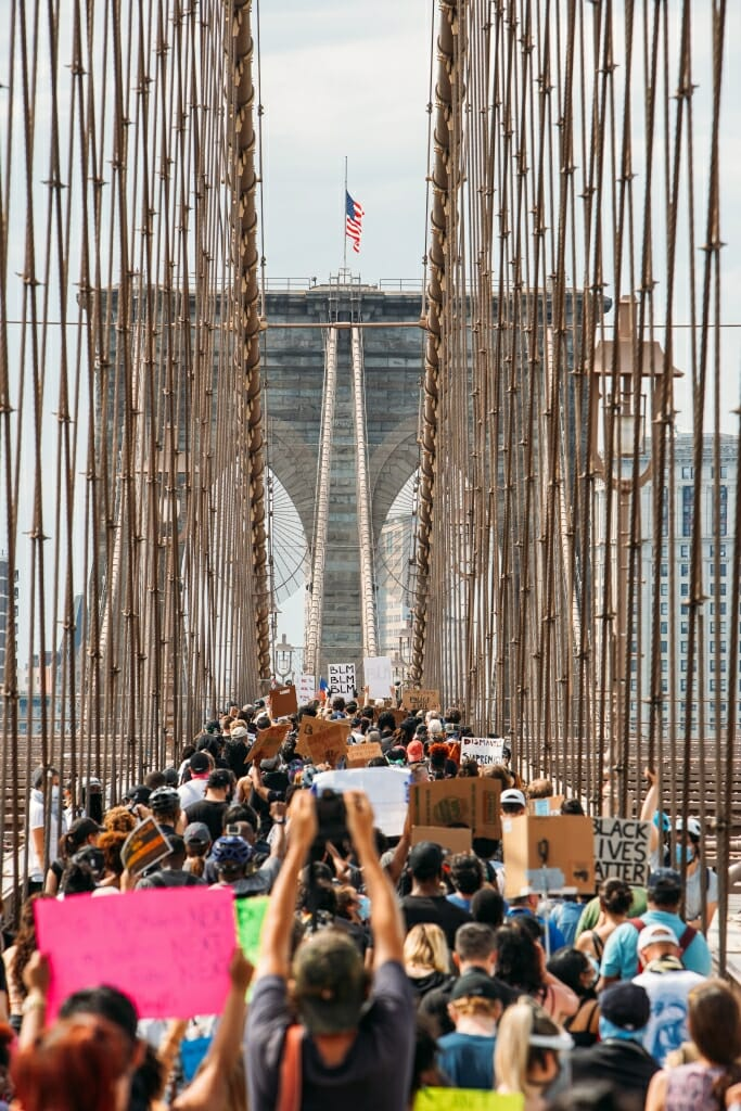 Protestors walk across the Brooklyn Bridge in support of Black Lives Matter