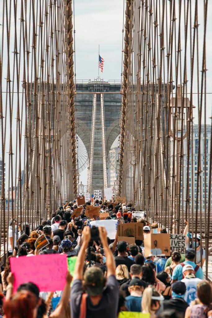 Protestors walk across the Brooklyn Bridge in support of Black Lives Matter